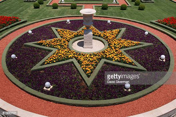 A starshaped flowerbed honors one of the symbols of Bahaism outside the Shrine of the Bab of the Bahai faith July 14 2008 in the northern Israeli...