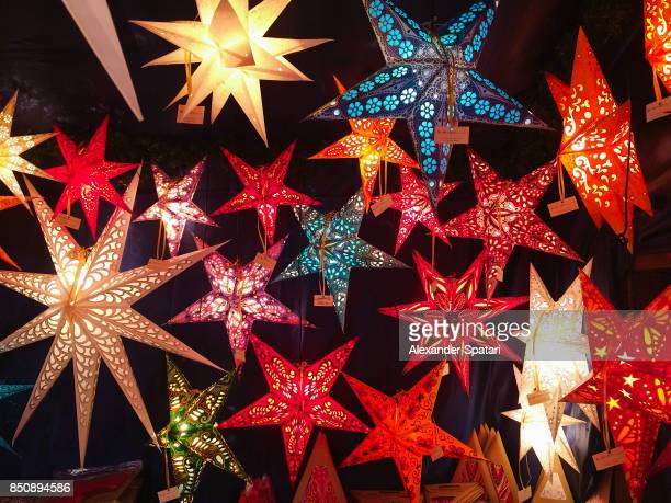 starshaped lanterns on christmas market in nurnberg, bavaria, germany - nuremberg stock photos and pictures