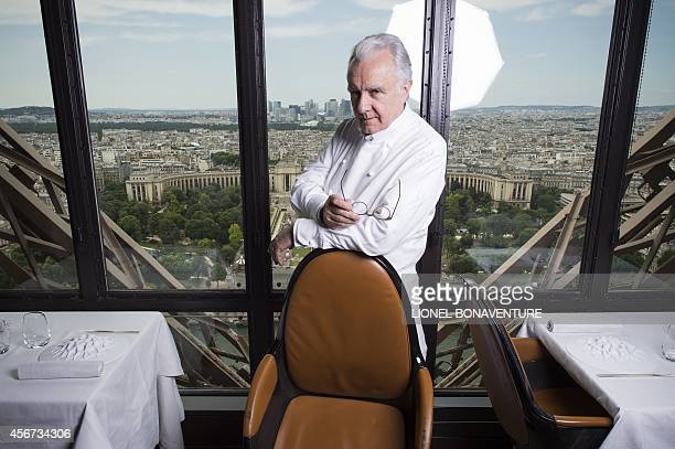 Starstudded French Chef Alain Ducasse poses in his restaurant 'Le Jules Verne' at the Eiffel Tower in Paris on June 23 2014 The restaurant offers a...