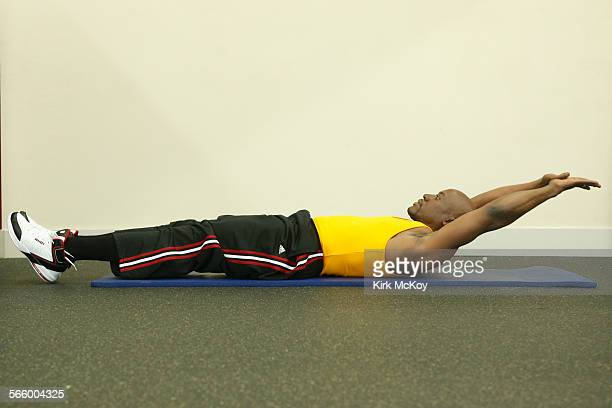 Start by lying down flat with your legs long abdominals tucked in and back pressed into the floor Extend your arms behind your head on the floor with...