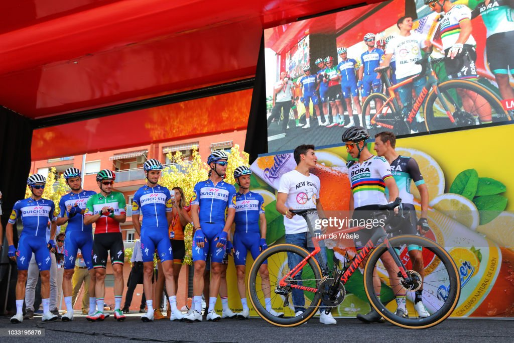 Start / Enric Mas of Spain and Team Quick-Step Floors / Kasper Asgreen of Denmarkand Team Quick-Step Floors / Elia Viviani of Italy and Team Quick-Step Floors / Pieter Serry of Belgium and Team Quick-Step Floors / Enric Mas of Spain and Team Quick-Step Floors / Fabio Sabatini of Italy and Team Quick-Step Floors / Dries Devenyns of Belgium and Team Quick-Step Floors / Marc Marquez of Spain Grand Prix Motorcycle road racer / Peter Sagan of Slovakia and Team Bora - Hansgrohe / Marcus Burghardt of Germany and Team Bora - Hansgrohe / during the 73rd Tour of Spain 2018, Stage 19 a 154,4km stage from Lleida to Naturlandia - Coll De La Rabassa 2025m / La Vuelta / on September 14, 2018 in Naturlandia - Coll De La Rabassa, Andorra.