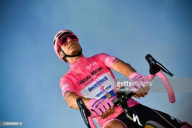 Start / Joao Almeida of Portugal and Team Deceuninck - Quick-Step Pink Leader Jersey / Base Aerea Rivolto / Peloton / during the 103rd Giro d'Italia...