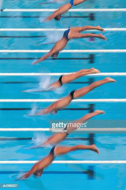start of mens swimming race - young men in speedos stock pictures, royalty-free photos & images