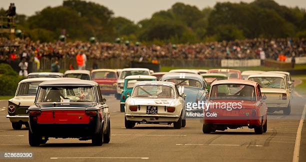 Start of St Mary's Trophy race 1965 Alfa Romeo Giulia Sprint GT car number 65 at The Goodwood Revival Meeting 15th Sept 2013