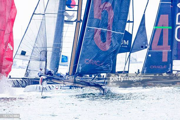 start of yacht race - catamaran race stock photos and pictures