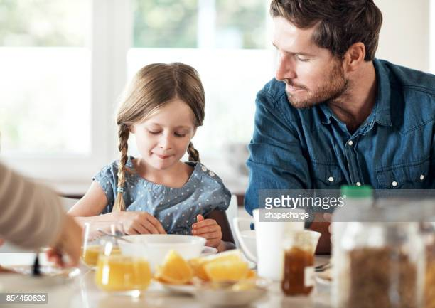 start the day right, with love and food - family at home stock photos and pictures