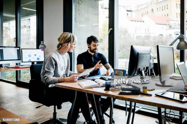 Start up business people discussing project on a computer