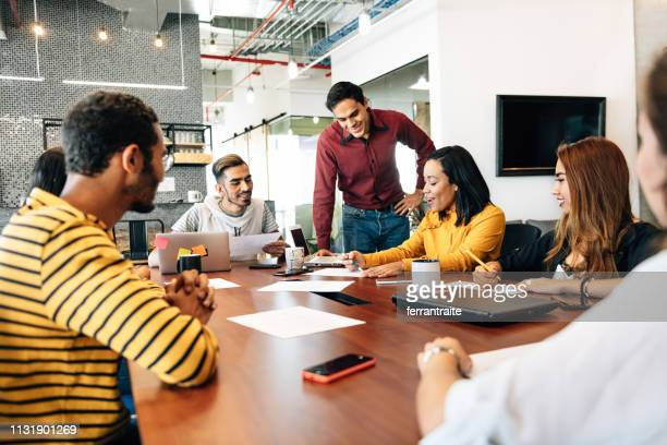 start up meeting in co-working office - latin america stock pictures, royalty-free photos & images