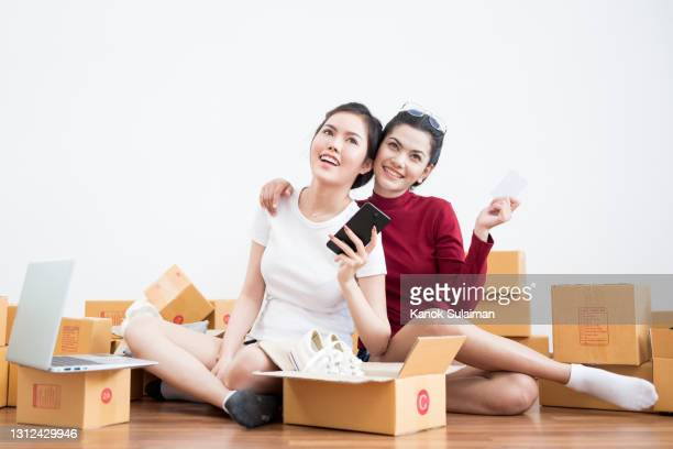 start up small business entrepreneur sme, new generation lifestyles of young entrepreneur using laptop and smartphone for online business - new generation stock pictures, royalty-free photos & images