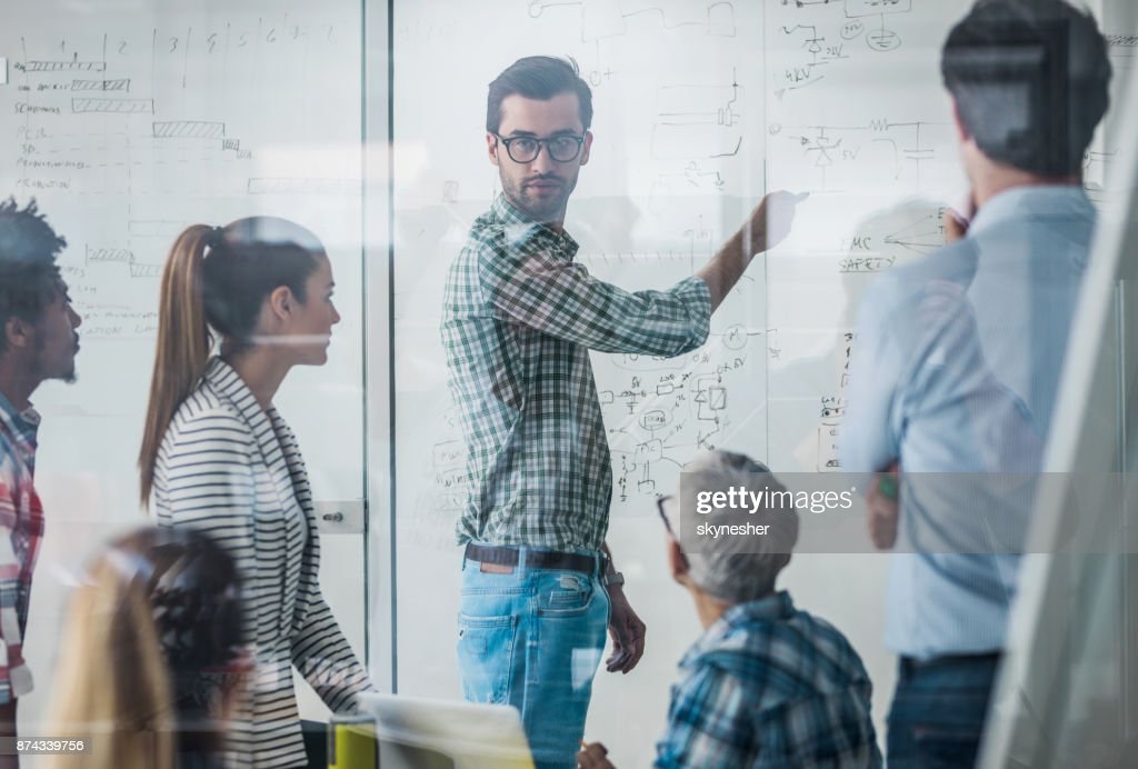 Start up team having a constructive meeting in the office. : Stock Photo
