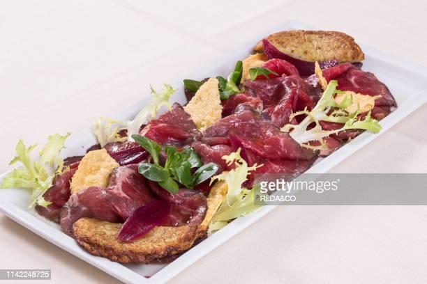 Starter about carne salada dish piatto di carne salada di propria produzione con tortel di patate e cipolla rossa in agrodolce Trattoria Carnera Ala...