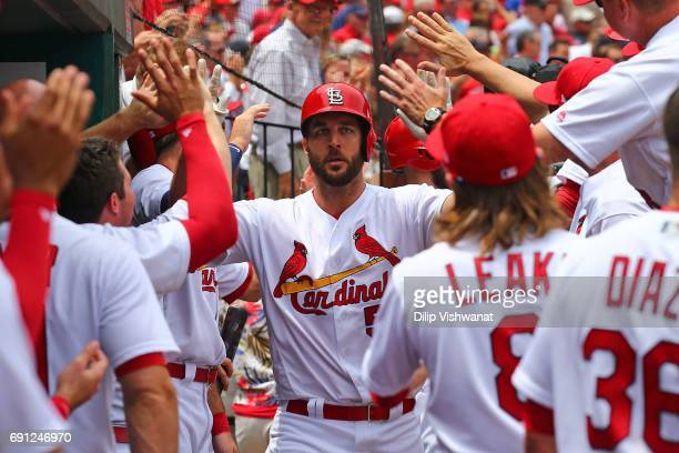 Starter Adam Wainwright of the St Louis Cardinals is congratulated by his teammates after hitting a tworun home run against the Los Angeles Dodgers...