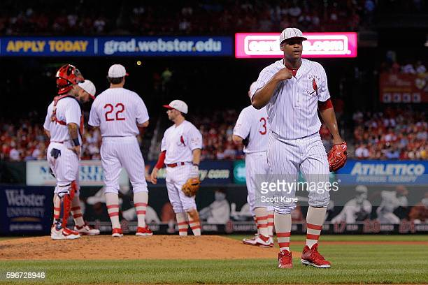 Starter Alex Reyes of the St Louis Cardinals walks to the dugout after being relieved from the mound during the fifth inning of a baseball game...