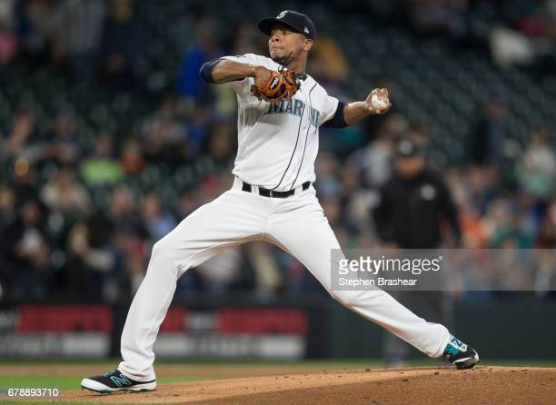 Starter Ariel Miranda of the Seattle Mariners delivers a pitch during the first inning of a game against the Los Angeles Angels of Anaheim at Safeco...