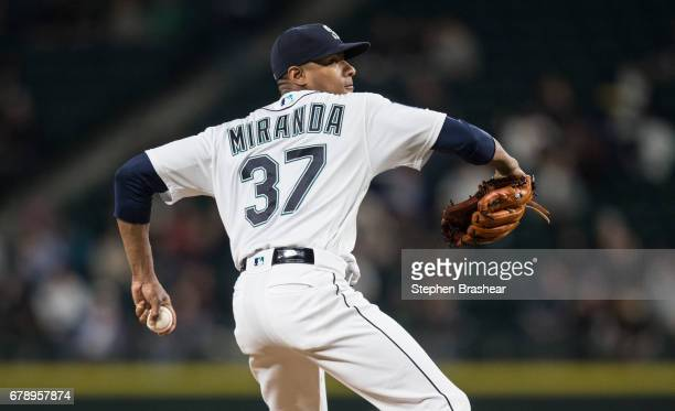 Starter Ariel Miranda of the Seattle Mariners delivers a pitch during the fourth inning of a game against the Los Angeles Angels of Anaheim at Safeco...