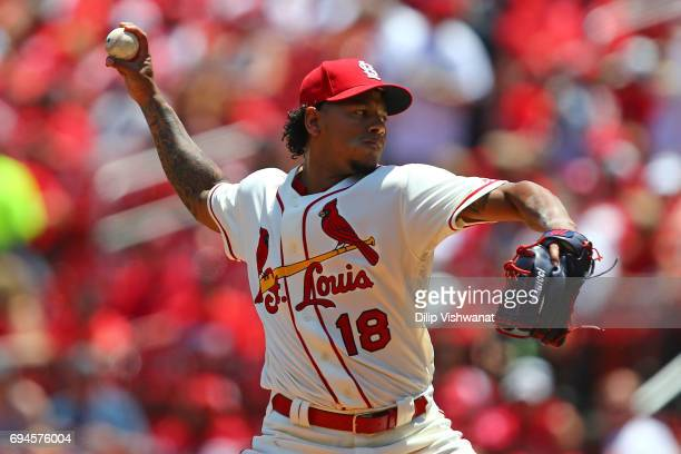 Starter Carlos Martinez of the St Louis Cardinals delivers a pitch against the Philadelphia Phillies in the first inning at Busch Stadium on June 10...