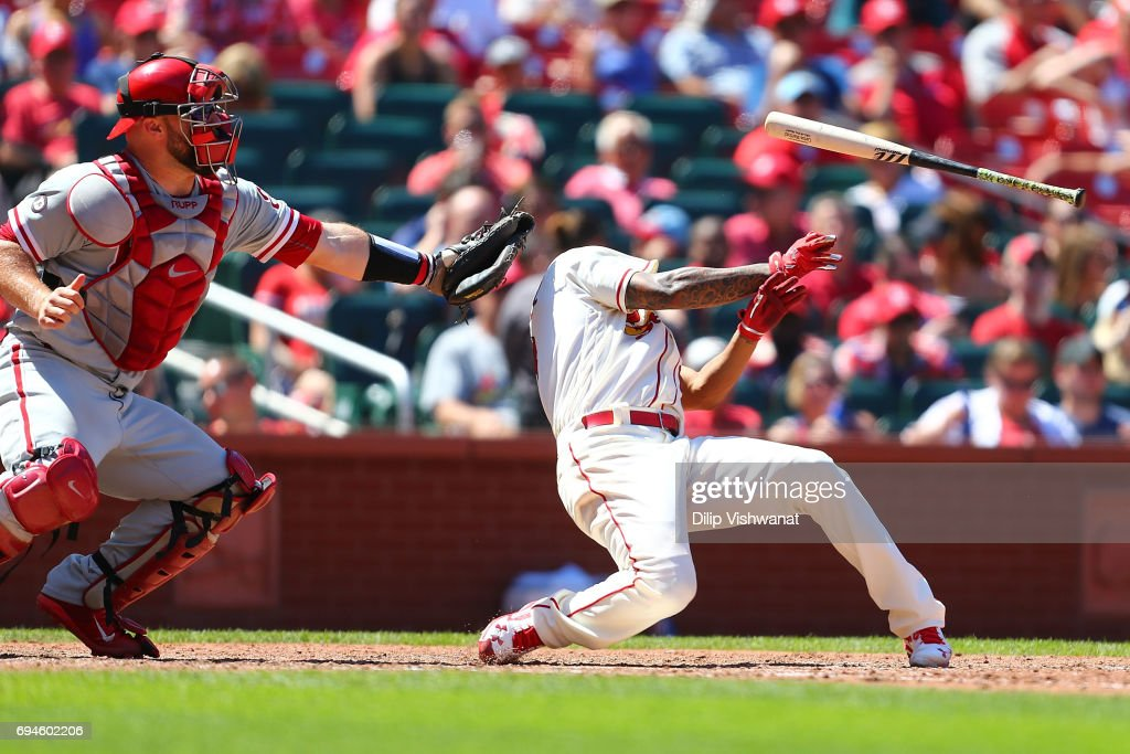 Starter Carlos Martinez #18 of the St. Louis Cardinals is hit by a pitch as Cameron Rupp #29 of the the Philadelphia Phillies catches in the seventh inning at Busch Stadium on June 10, 2017 in St. Louis, Missouri.