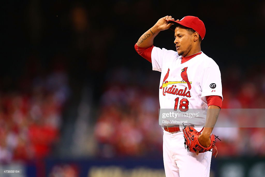 Starter Carlos Martinez #18 of the St. Louis Cardinals reacts after giving up a solo home run against the Detroit Tigers in the second inning at Busch Stadium on May 15, 2015 in St. Louis, Missouri.
