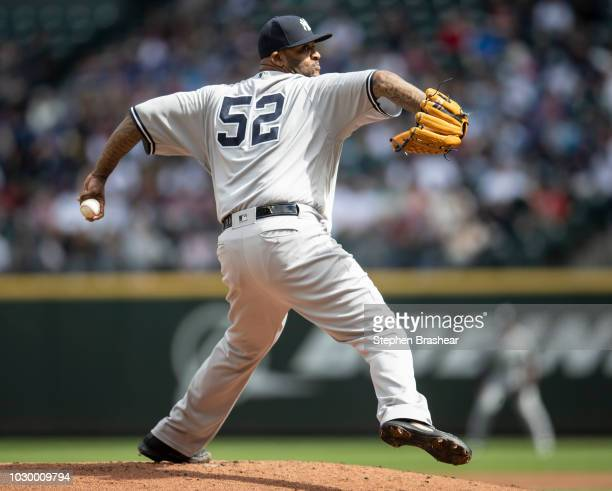 Starter CC Sabathia of the New York Yankees delivers a pitch during the first inning of a game against the Seattle Mariners at Safeco Field on...