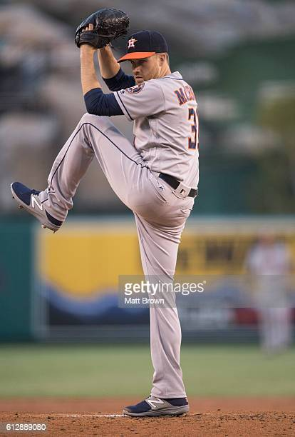 Starter Collin McHugh of the Houston Astros pitches during the first inning of the game against the Los Angeles Angels of Anaheim at Angel Stadium of...
