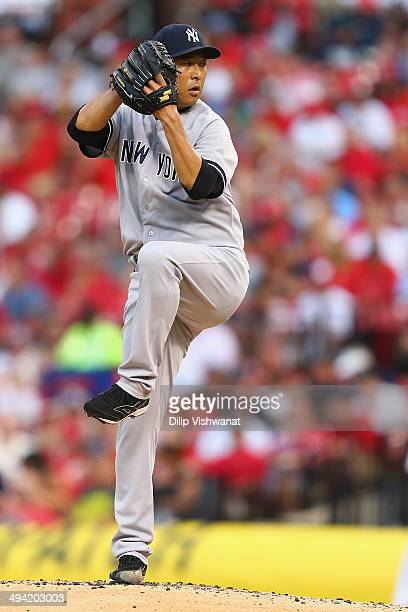 Starter Hiroki Kuroda of the New York Yankees pitches against the St Louis Cardinals in the first inning at Busch Stadium on May 28 2014 in St Louis...