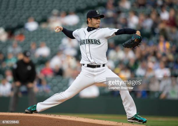 Starter Hisashi Iwakuma of the Seattle Mariners delivers a pitch during the first inning of a game against the Los Angeles Angels of Anaheim at...