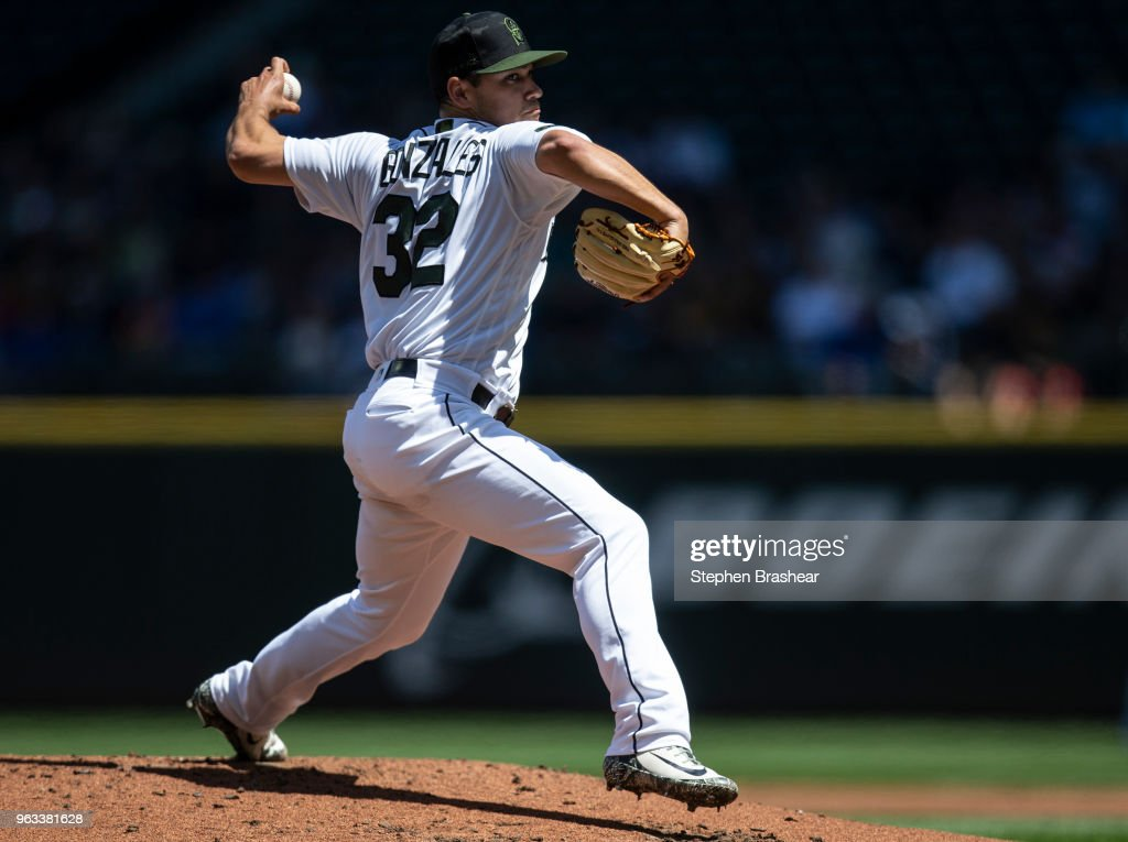 Starter Marco Gonzales #32 of the Seattle Mariners delivers a pitch during the second inning of a gameagainst the Texas Rangers at Safeco Field on May 28, 2018 in Seattle, Washington. MLB players across the league are wearing special uniforms to commemorate Memorial Day.