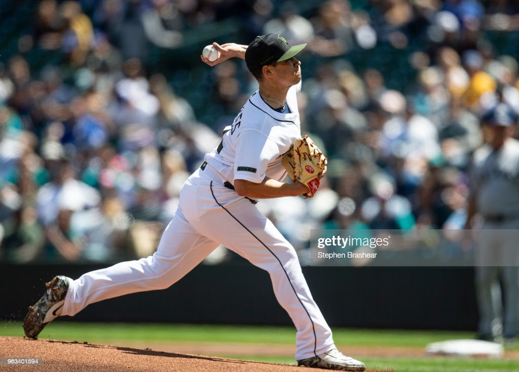 Starter Marco Gonzales #32 of the Seattle Mariners delivers a pitch during the first inning of a game against the Texas Rangers at Safeco Field on May 28, 2018 in Seattle, Washington. The Mariners won the game 2-1. MLB players across the league are wearing special uniforms to commemorate Memorial Day.