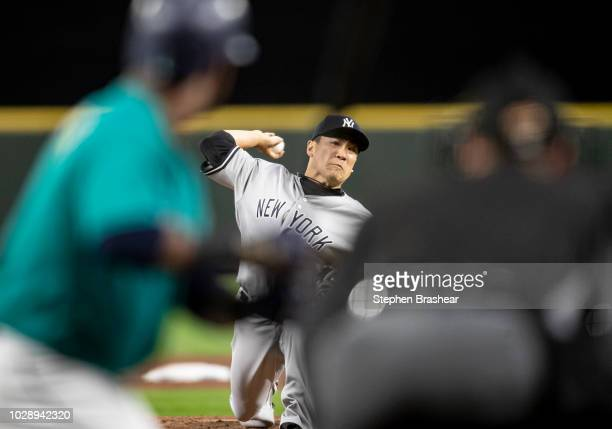 Starter Masahiro Tanaka of the New York Yankees delivers a pitch during the sixth inningn of a game against the Seattle Mariners at Safeco Field on...