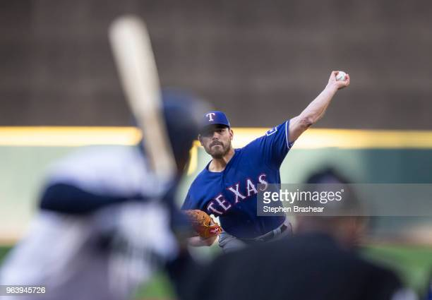 Starter Matt Moore of the Texas Rangers delivers a pitch during the first inning of a game against the Seattle Mariners at Safeco Field on May 30...