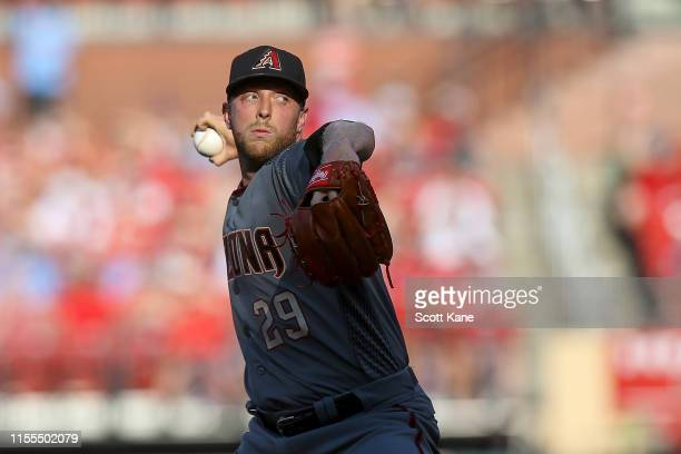 Starter Merrill Kelly of the Arizona Diamondbacks delivers during the first inning against the St. Louis Cardinals at Busch Stadium on July 13, 2019...