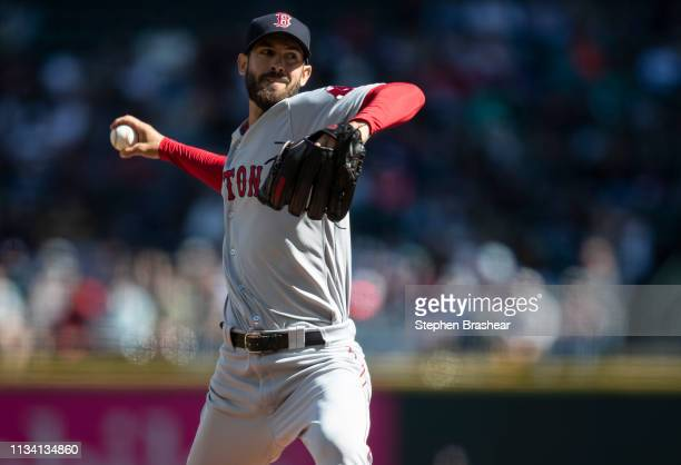 Starter Rick Porcello of the Boston Red Sox delivers a pitch during the first inning of a game against the Seattle Mariners at TMobile Park on March...