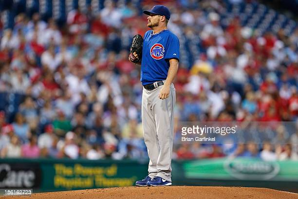Starter Travis Wood of the Chicago Cubs prepares to throw a pitch in the first inning of the game against the Philadelphia Phillies at Citizens Bank...