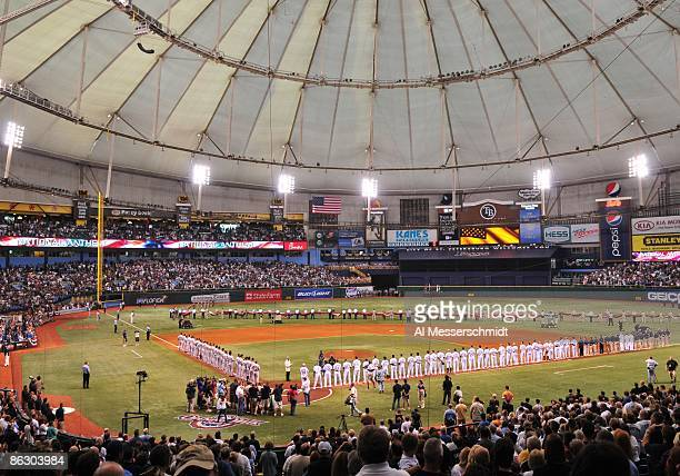 Starters of the Tampa Bay Rays line up for the National Anthem before play against the New York Yankees on April 13 2009 at Tropicana Field in St...