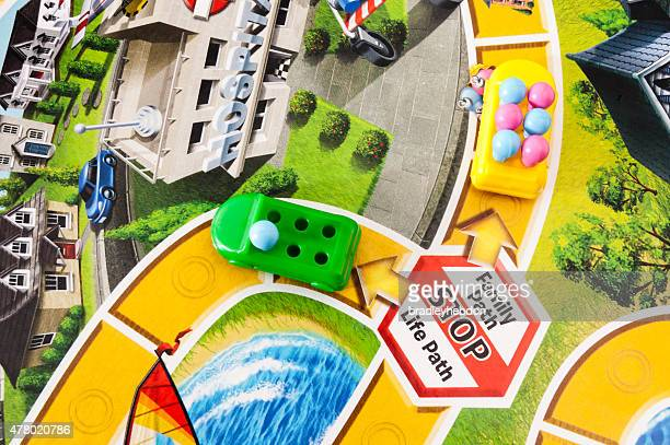 starting a family in the game of life - game board stock photos and pictures
