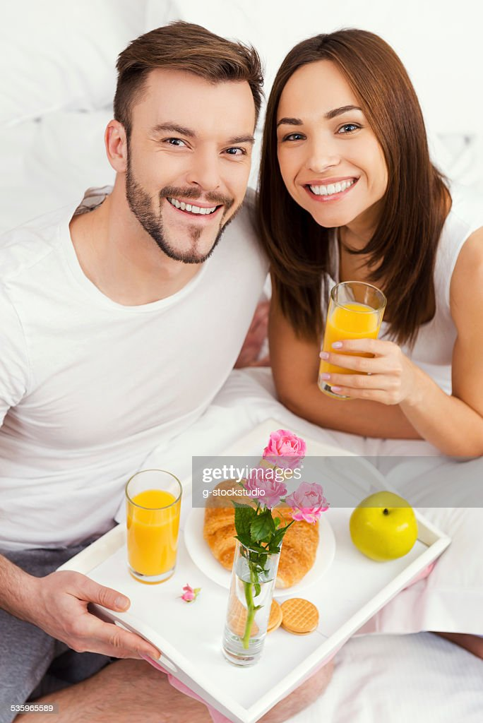 Starting a good day with breakfast in bed. : Stock Photo