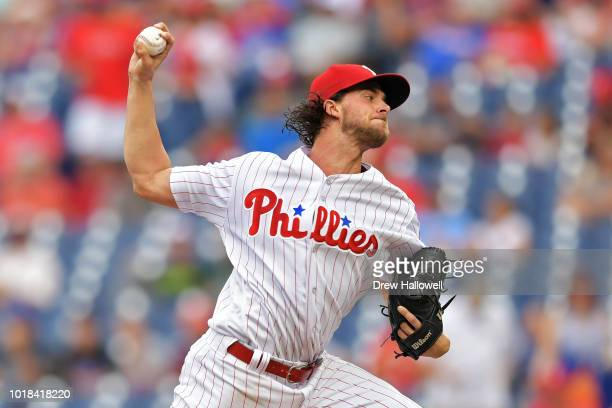 Starting Aaron Nola of the Philadelphia Phillies delivers a pitch in the first inning against the New York Mets at Citizens Bank Park on August 17...