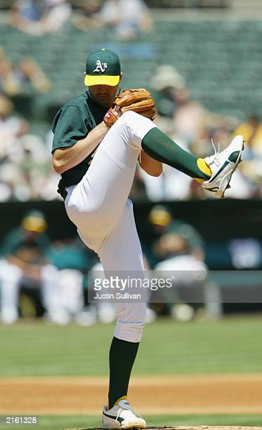 Starting Barry Zito of the Oakland Athletics winds up for a pitch during the American League game against the Seattle Mariners on July 3, 2003 at the...