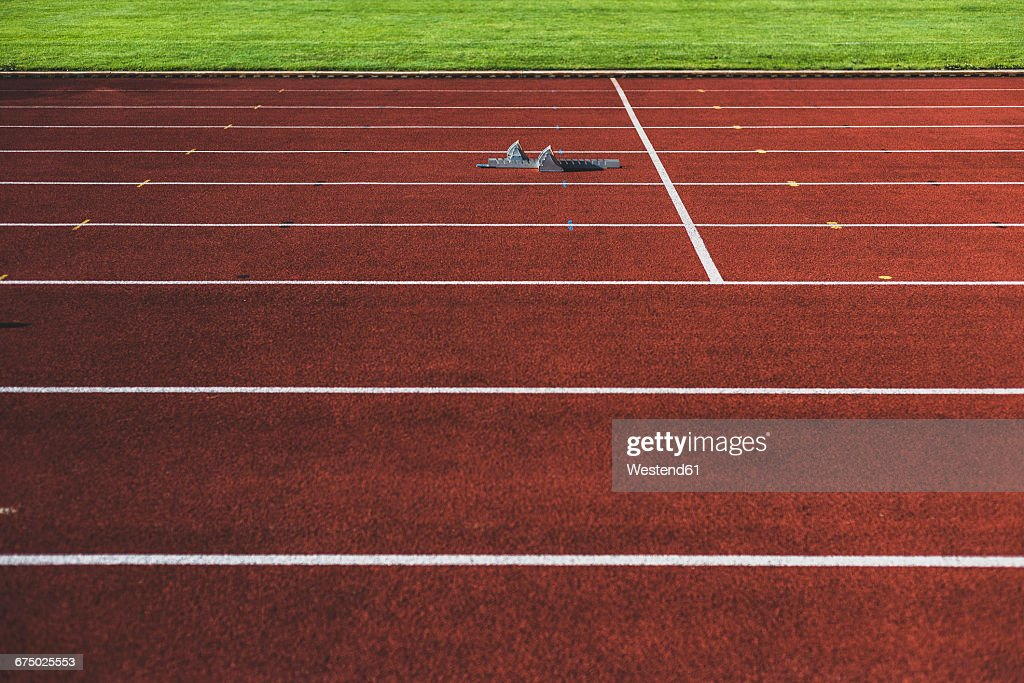Starting block on tartan track : Stock Photo