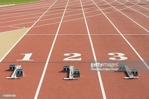 Starting blocks at starting line on running track