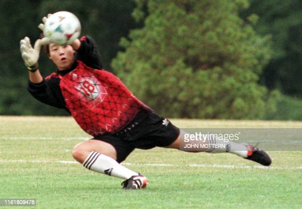 Starting goalie Gao Hong of China's Women's World Cup soccer team takes charge during a practice session at Babson College 02 July 1999 in Wellesley...