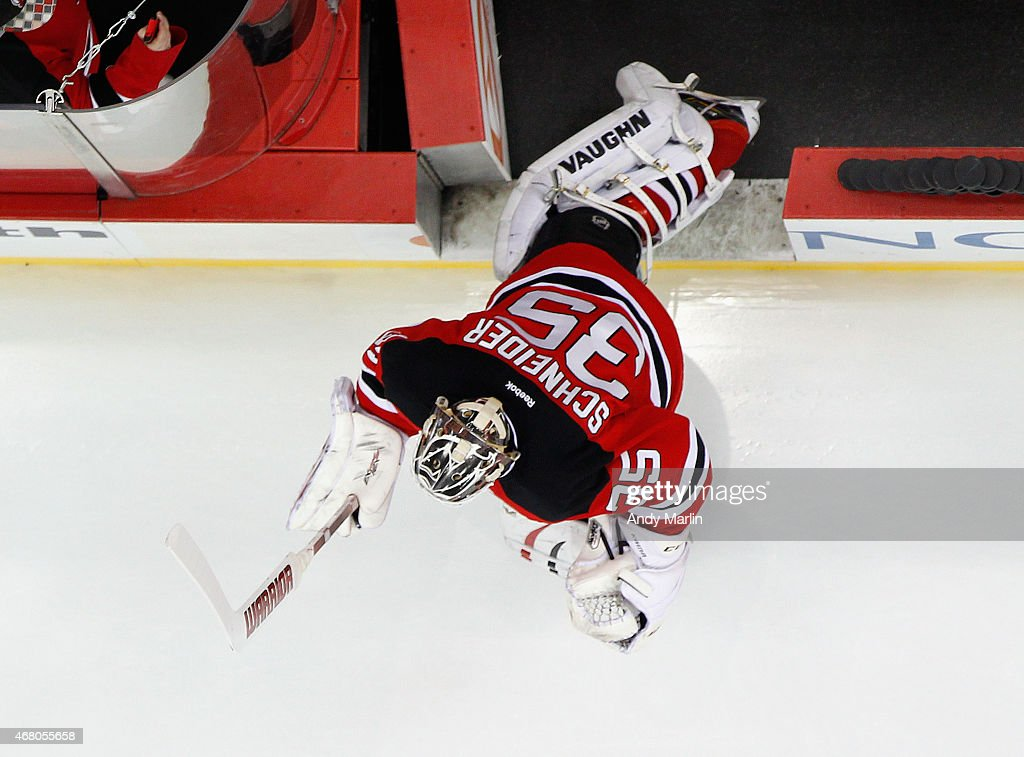Starting goaltender Cory Schneider #35 of the New Jersey Devils takes the ice for pregame warmups prior to the game against the Anaheim Ducks at the Prudential Center on March 29, 2015 in Newark, New Jersey.