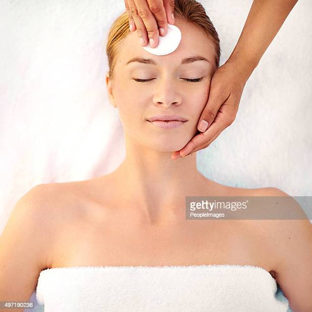 Starting her facial with a gentle cleanser