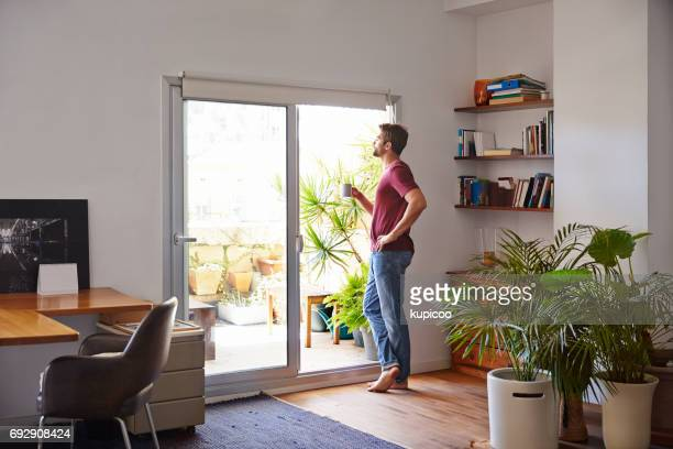 starting his day off perfectly - balcony stock photos and pictures