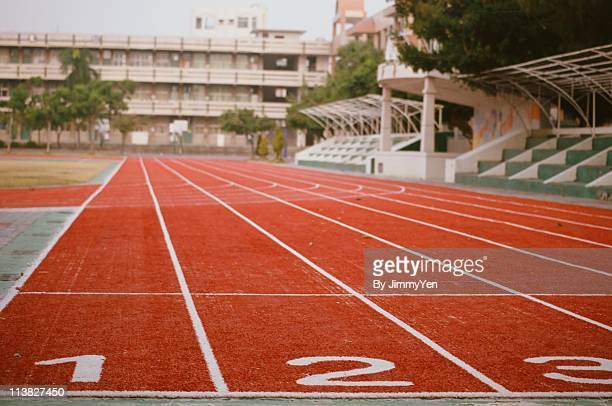 starting line - track and field stadium stock pictures, royalty-free photos & images