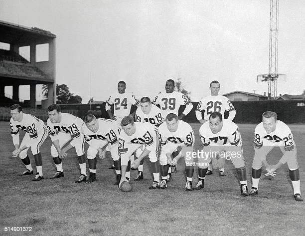 Starting offensive lineup for the West AllStar Pro Bowl team Left to right Ray Berry Colts Bob St Clair 49ers Stan Jones Bears Jim Ringo Packers Art...