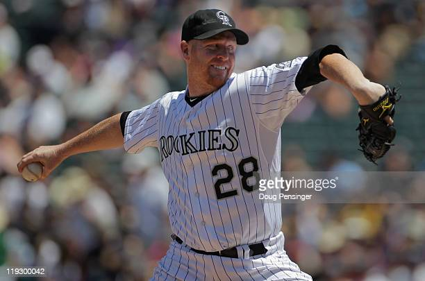 Starting pitcher Aaron Cook of the Colorado Rockies delviers against the Milwaukee Brewers at Coors Field on July 17 2011 in Denver Colorado