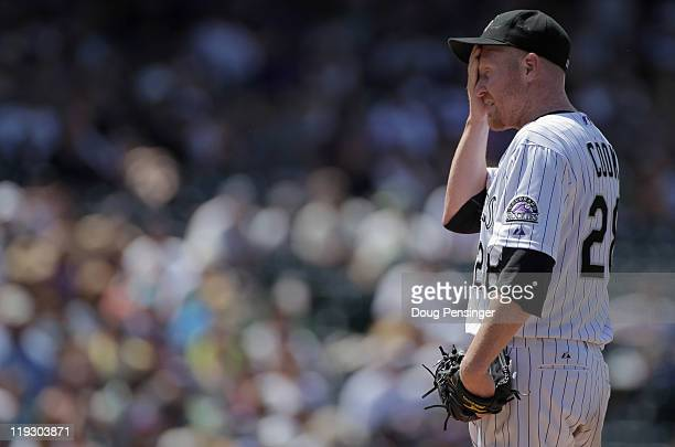 Starting pitcher Aaron Cook of the Colorado Rockies looks on as he works against the Milwaukee Brewers at Coors Field on July 17 2011 in Denver...