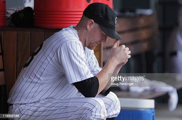 Starting pitcher Aaron Cook of the Colorado Rockies looks on from the dugout after being removed from the game in the fifth inning against the...
