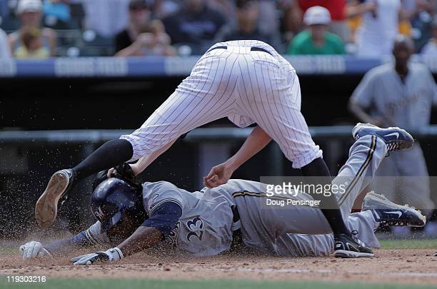 Starting pitcher Aaron Cook of the Colorado Rockies tags out Rickie Weeks of the Milwaukee Brewers at the plate after he was caught in a rundown on a...